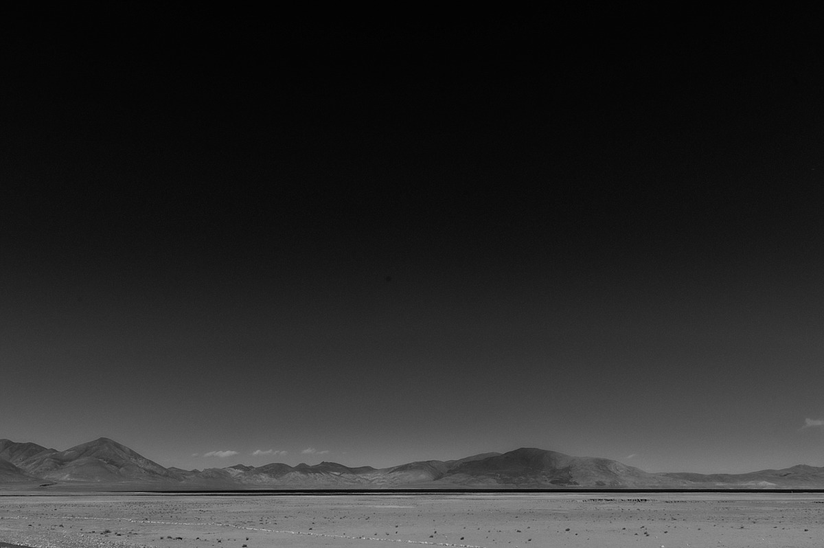Black& White photo of lake in the mountains
