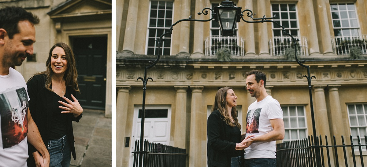 Couple standing in front of buildings in Bath city
