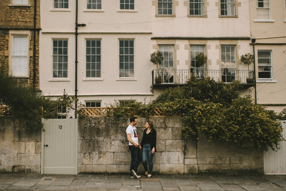 Couple in front of houses in Bath city