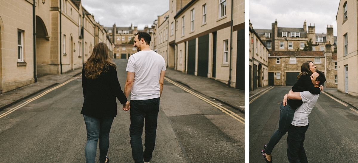 couple on engagement photo shoot walking down a street in Bath city