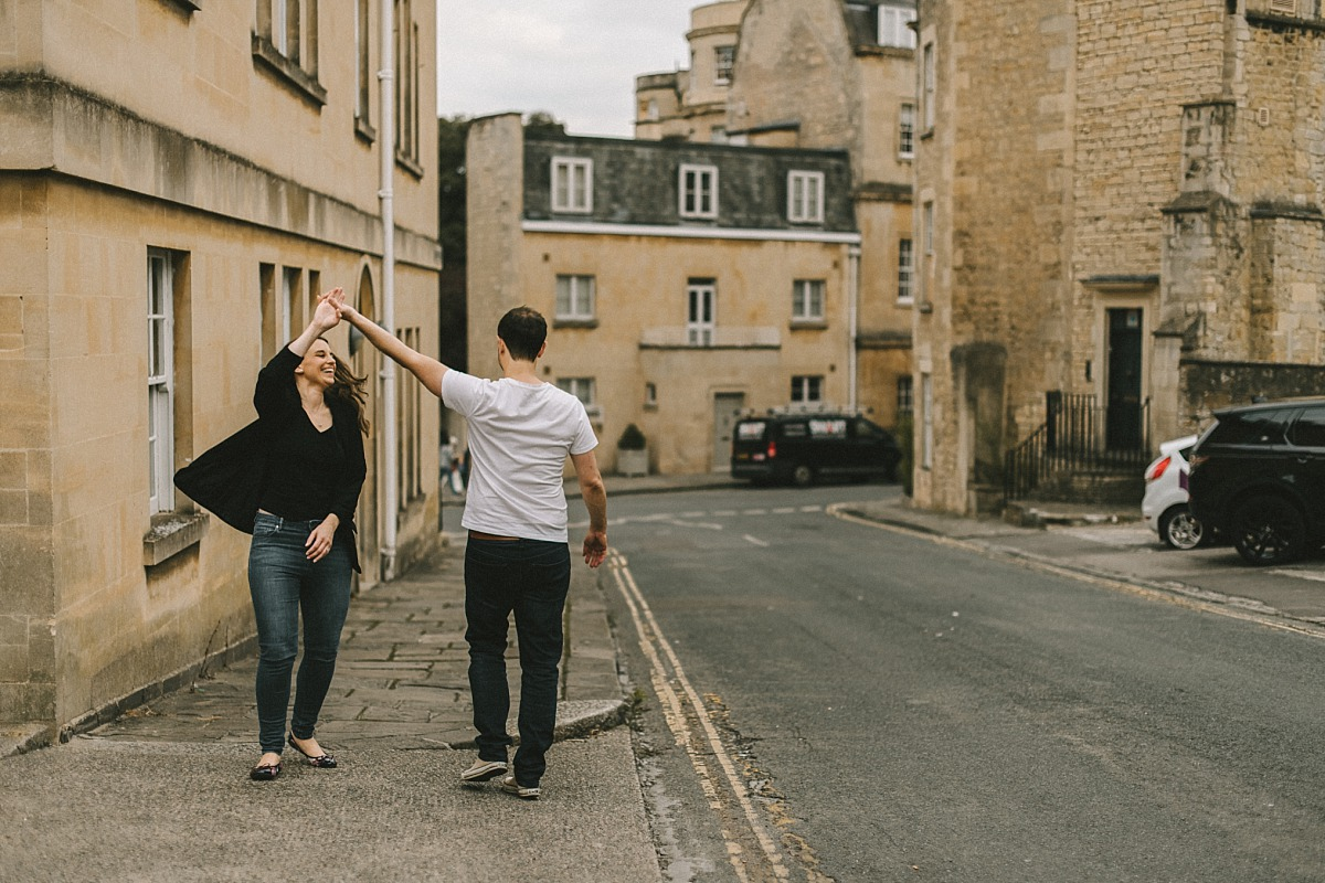 couple having fun in street in Bath city