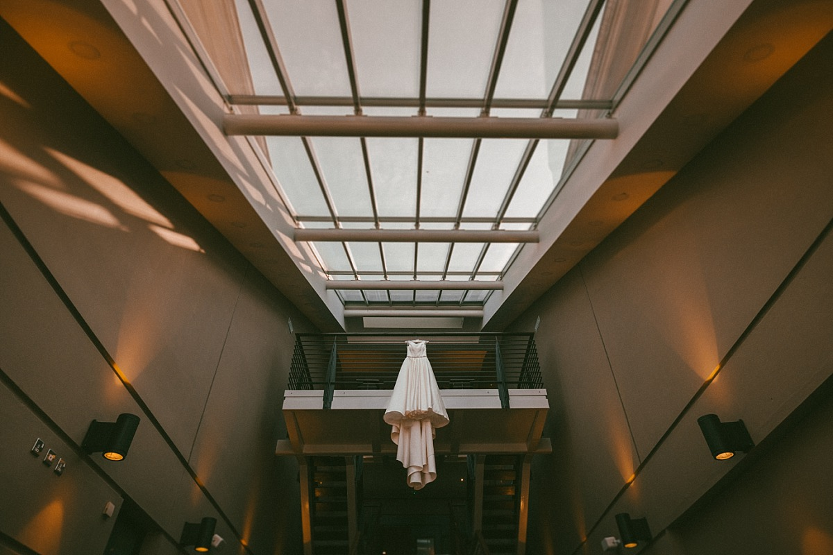 Wedding dress hanging in large room in Wokefield Estate