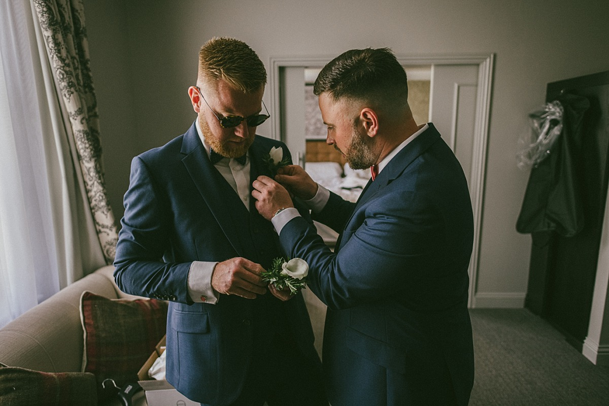 Groom helping his Groomsmen to get ready