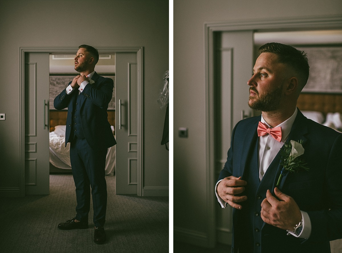 Stylish Groom in Blue suit and pink bow tie