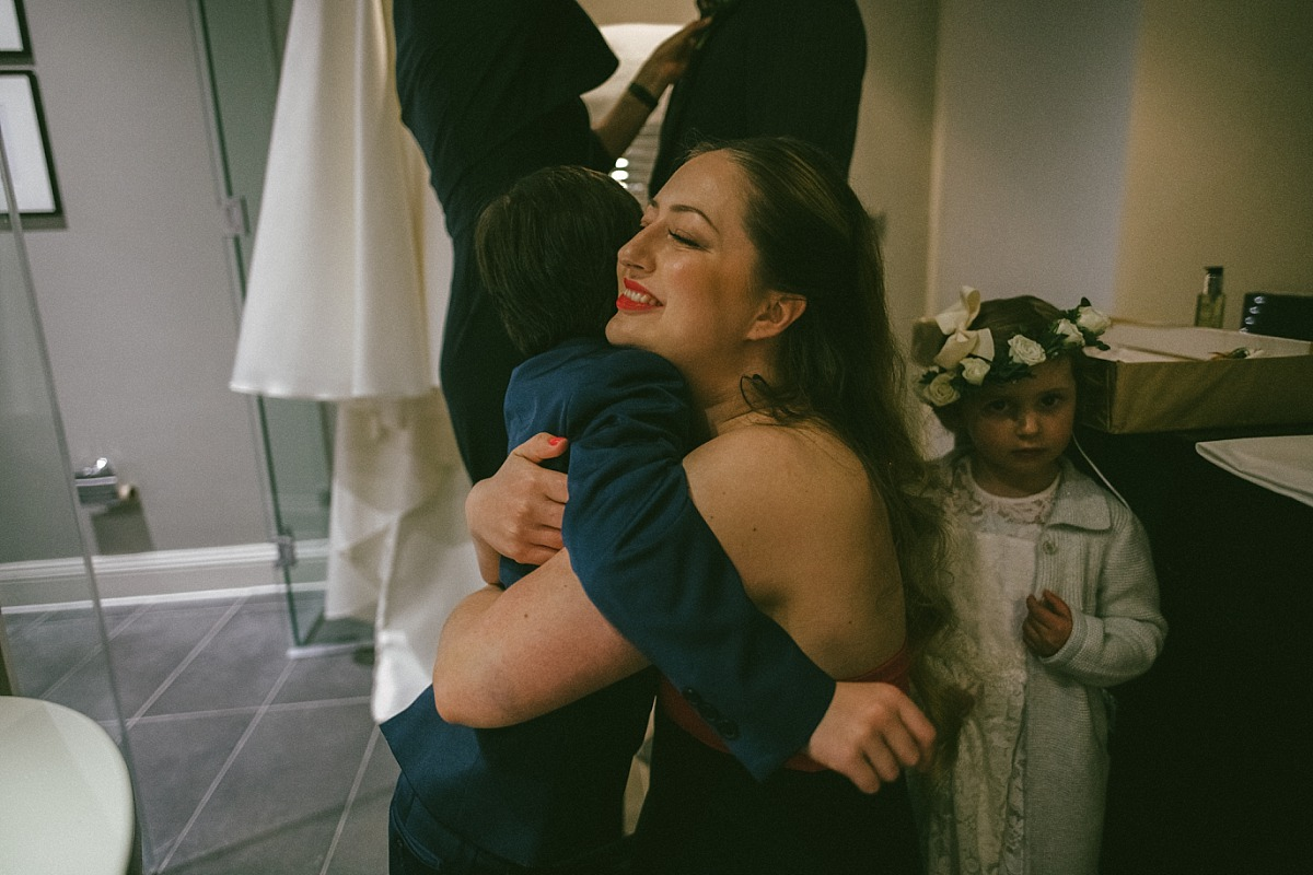 Bride to be hugging young relative by Reading Wedding Photographer