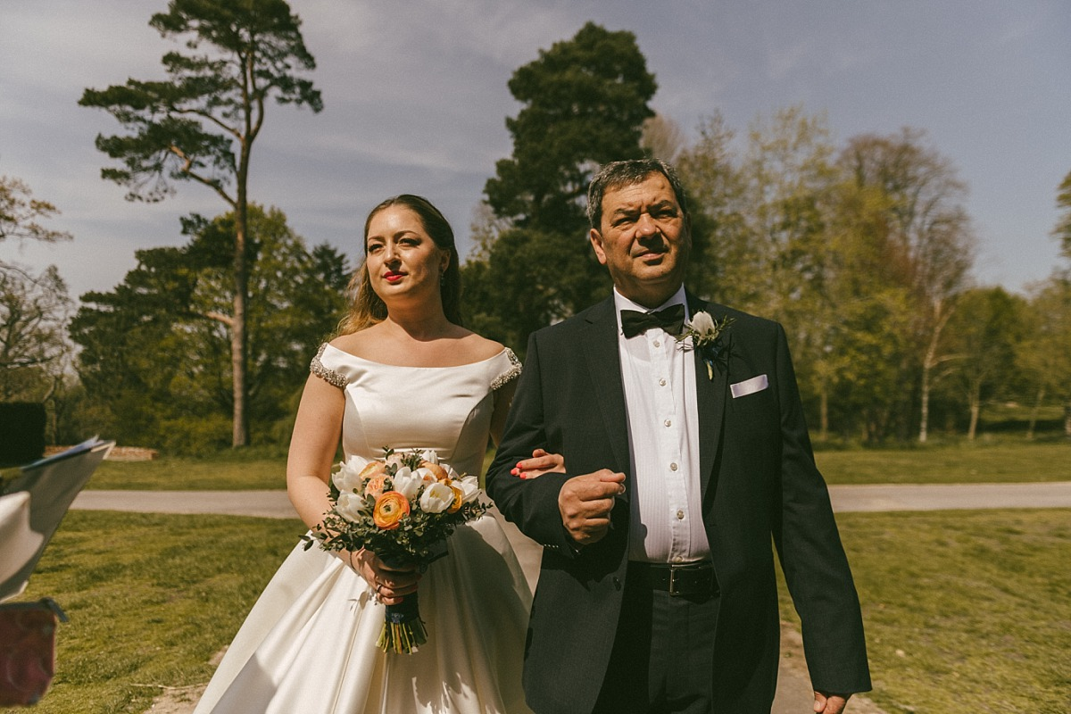 Photo of Bride and father on bright sunny day