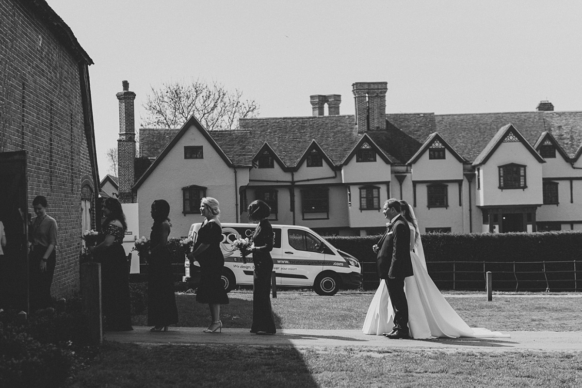 Black & White photo of wedding party entering wedding ceremony