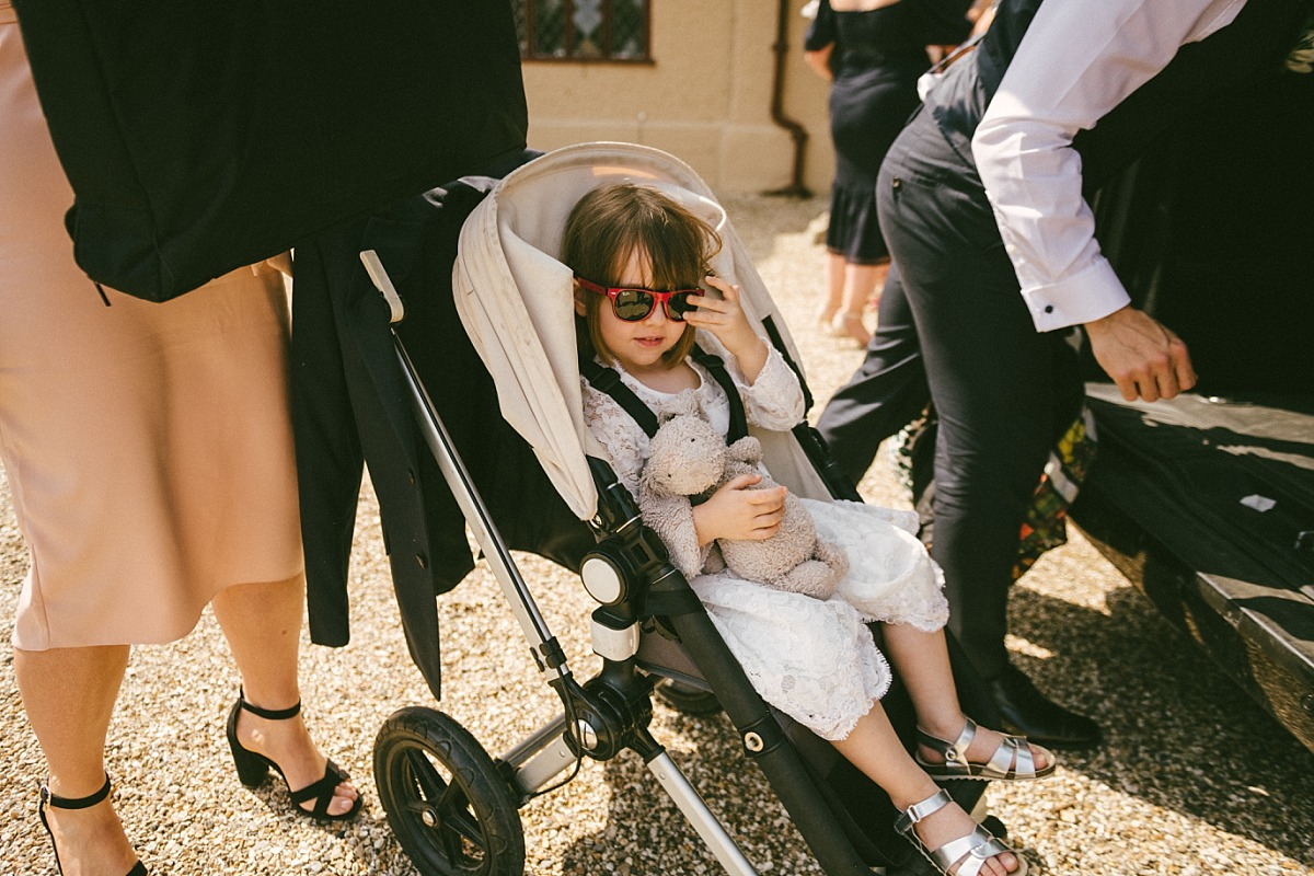 Young girl wearing sun glasses at wedding day