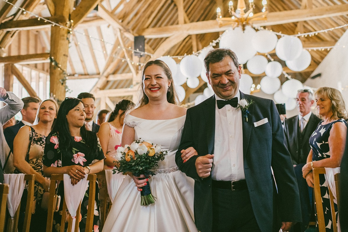 Bride & Father entering wedding venue by Matt Lee Photography