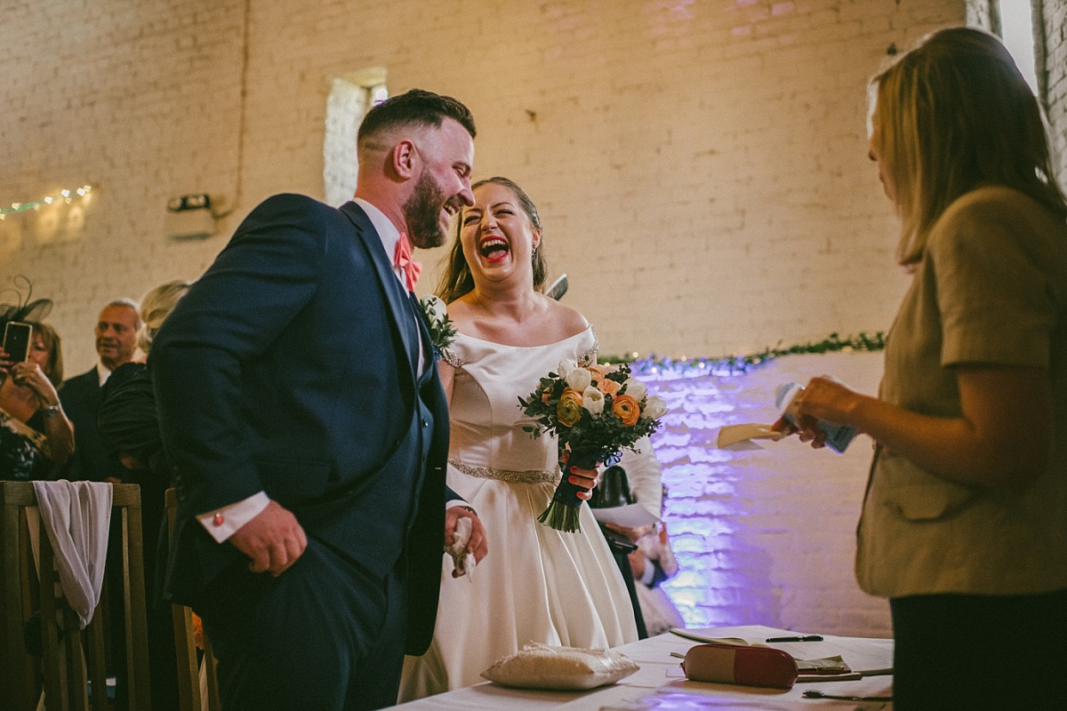 Bride laughing with Groom at wedding ceremony