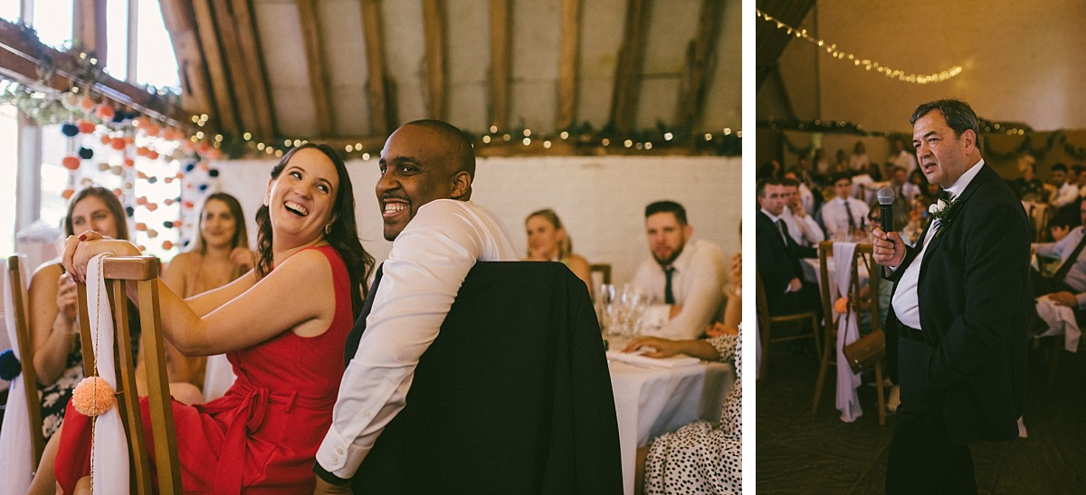 Man & girlfriend laughing at wedding speeches
