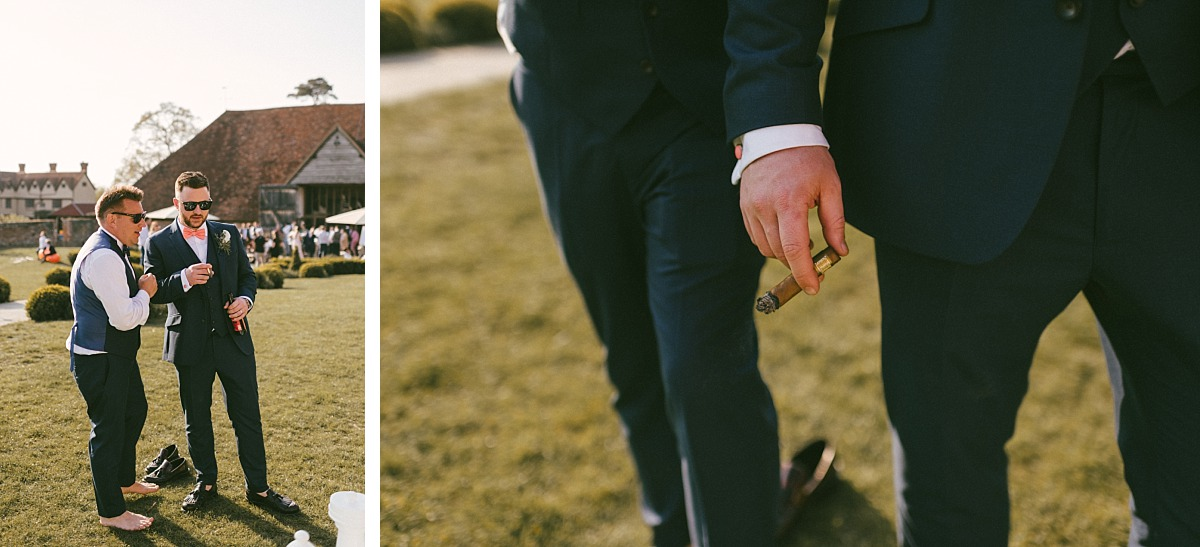 Groom and friend smoking a cigar and laughing