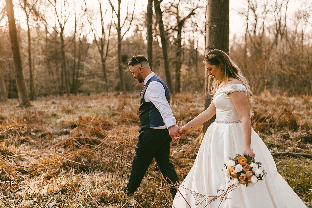 Stylish Bride & Groom walking through long grass