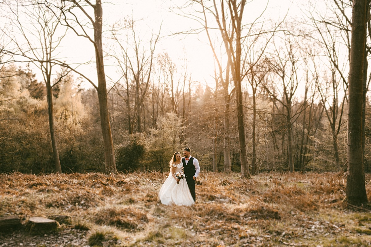 Cool photo of Bride & Groom in field with sunset behind