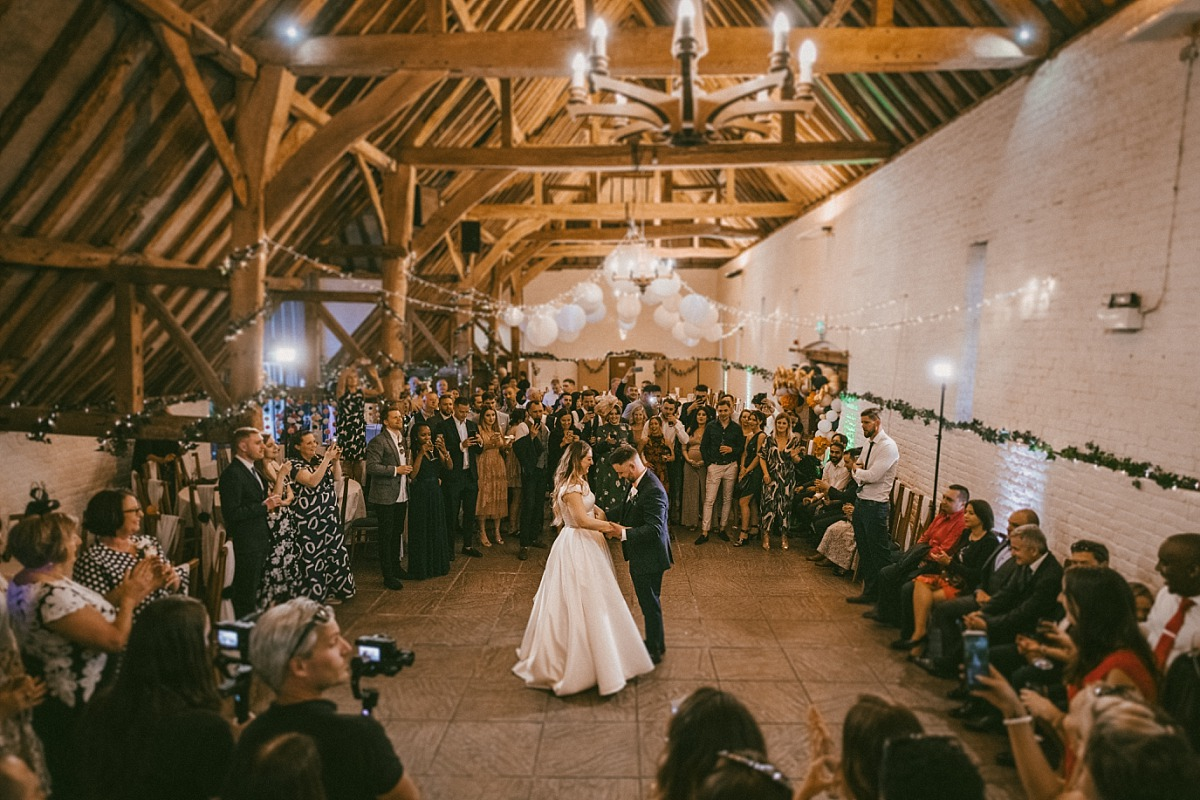 First dance at wedding inside the Barn by Reading wedding photographer