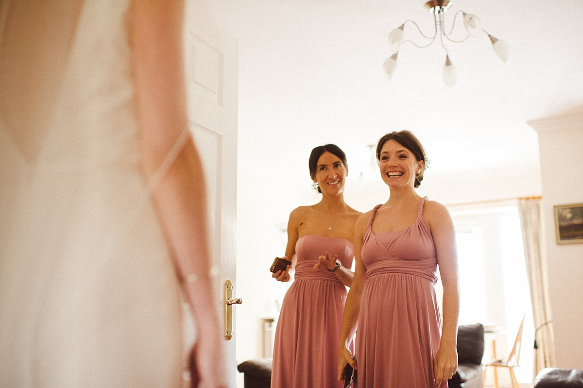 colour image of bridesmaids seeing bride