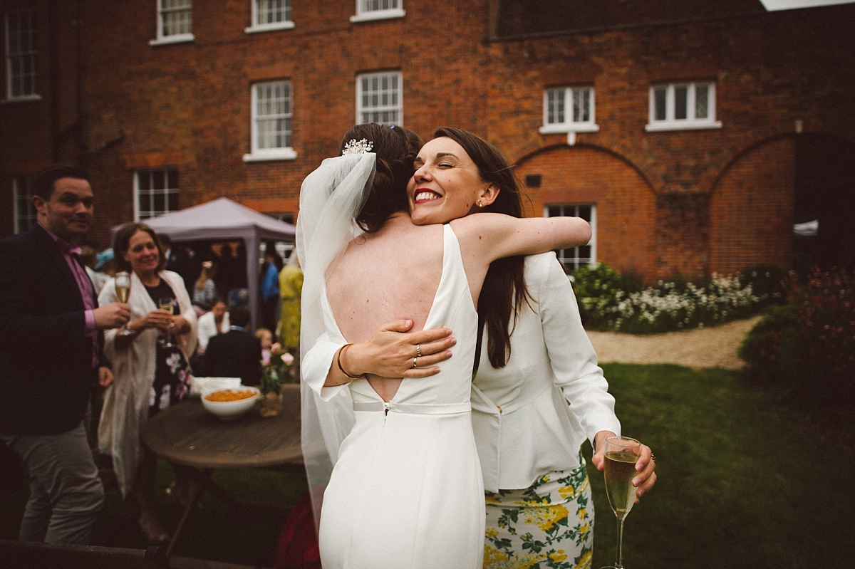 bride hugging friend at Rownhams House