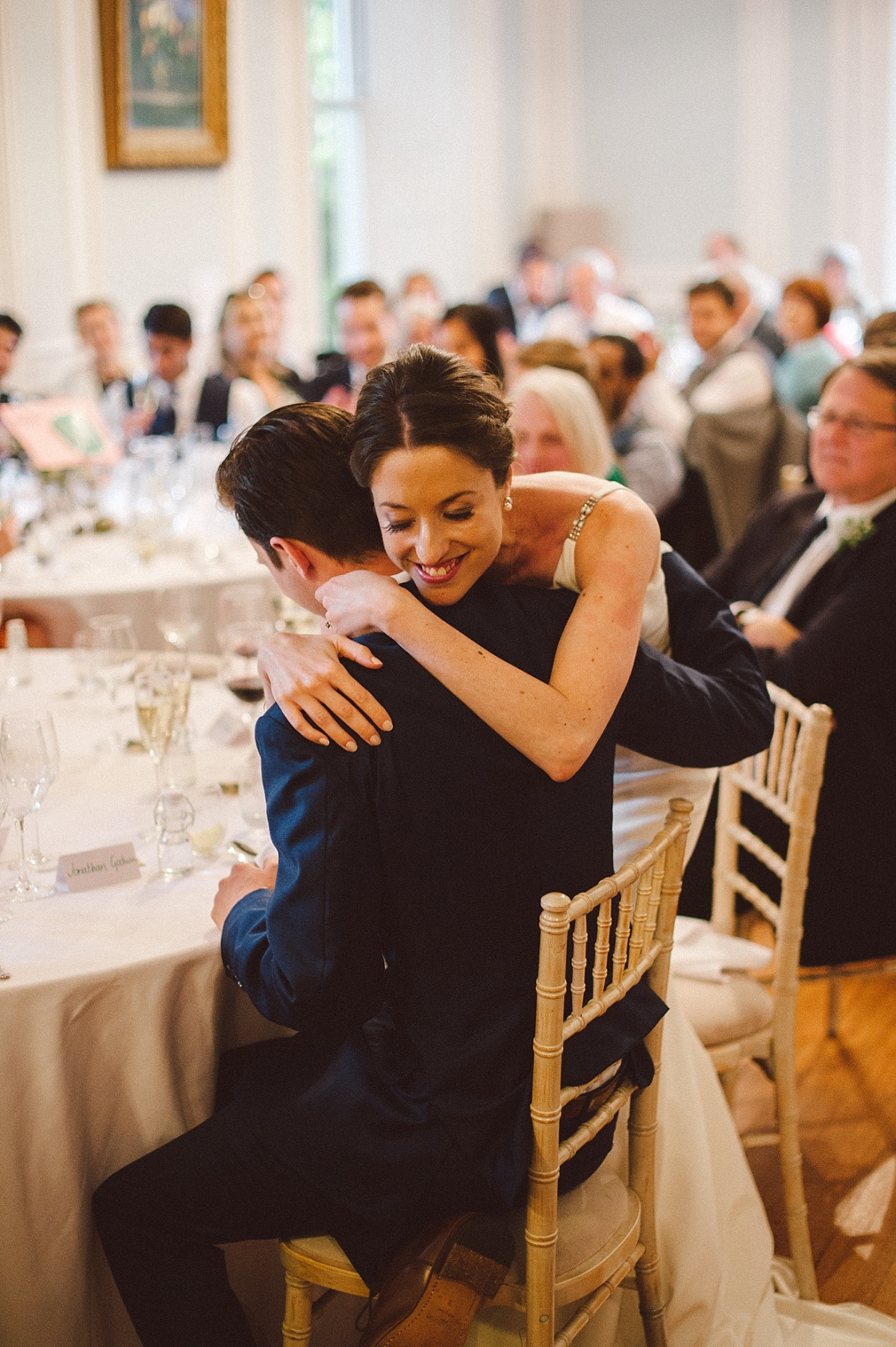 bride hugging groom during wedding speeches