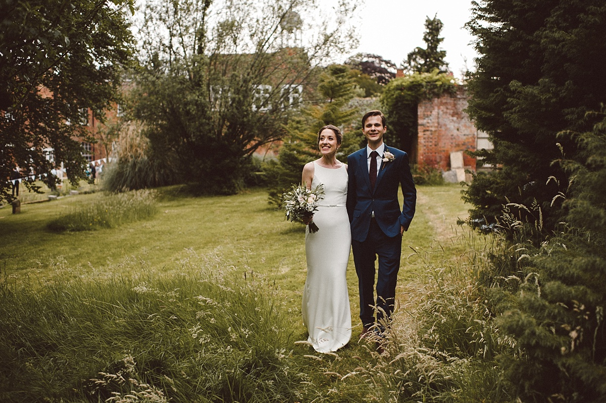 smiling bride in Gardens of Rownhams House