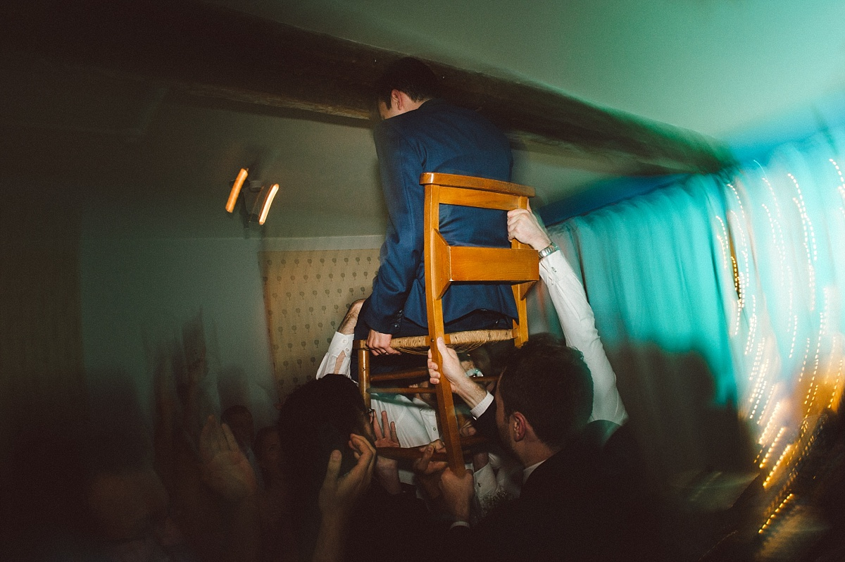 photo of Groom being carried on a chair