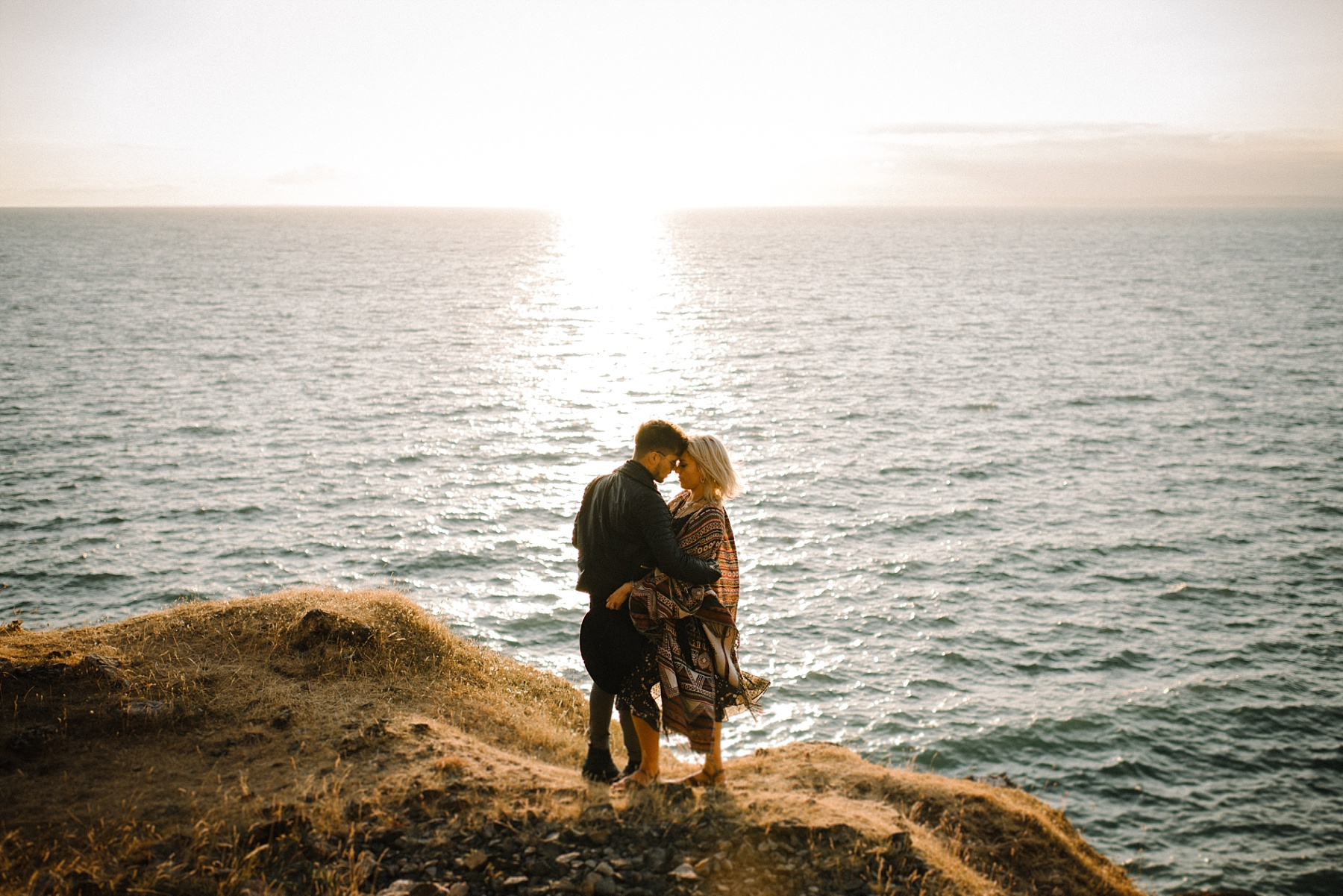 Photo of couple in sunset by South Wales wedding photographer