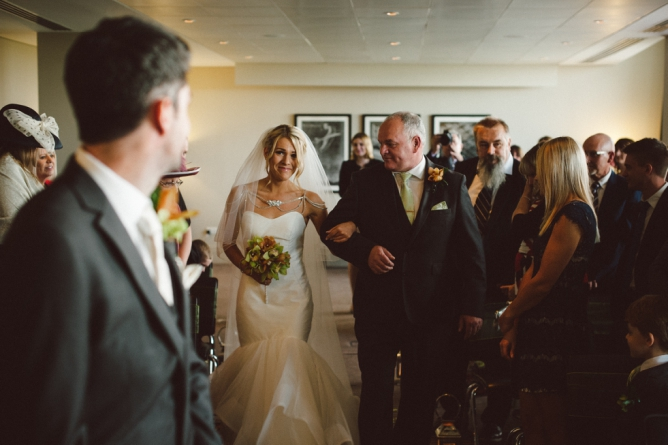 Bride walking down aisle at The Aviator Farnborough