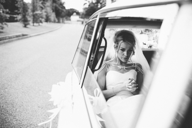 Nervous Bride waiting in wedding car