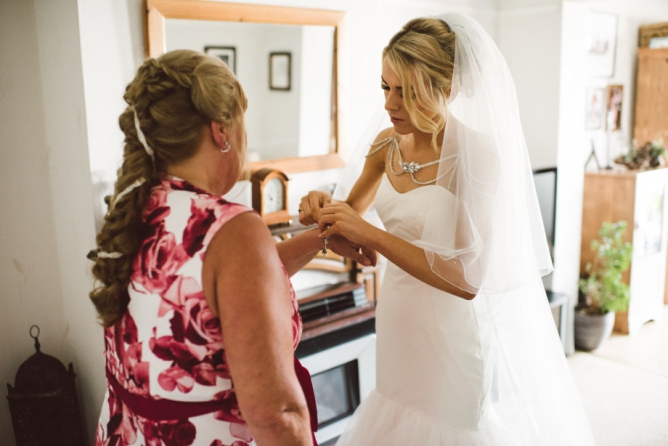 Mother of bride helping Bride get ready