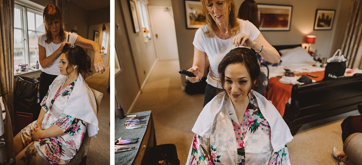 Bride having hair done in morning prep