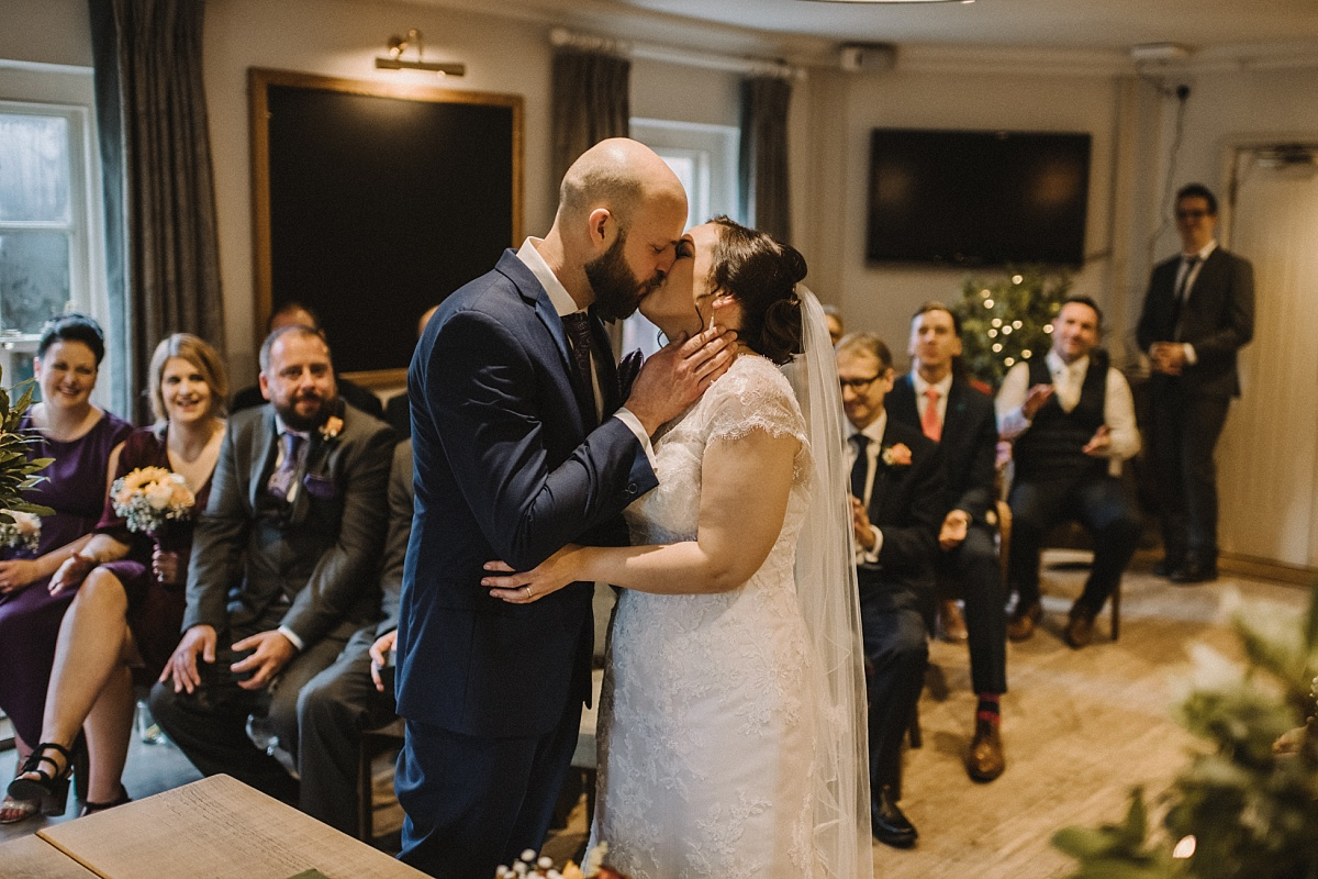 groom kisses wife after saying I do