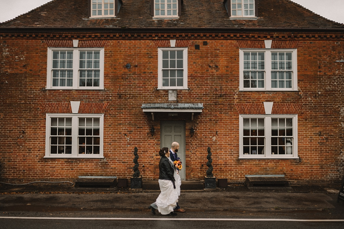 married couplewalking past The Bell Inn New Forest