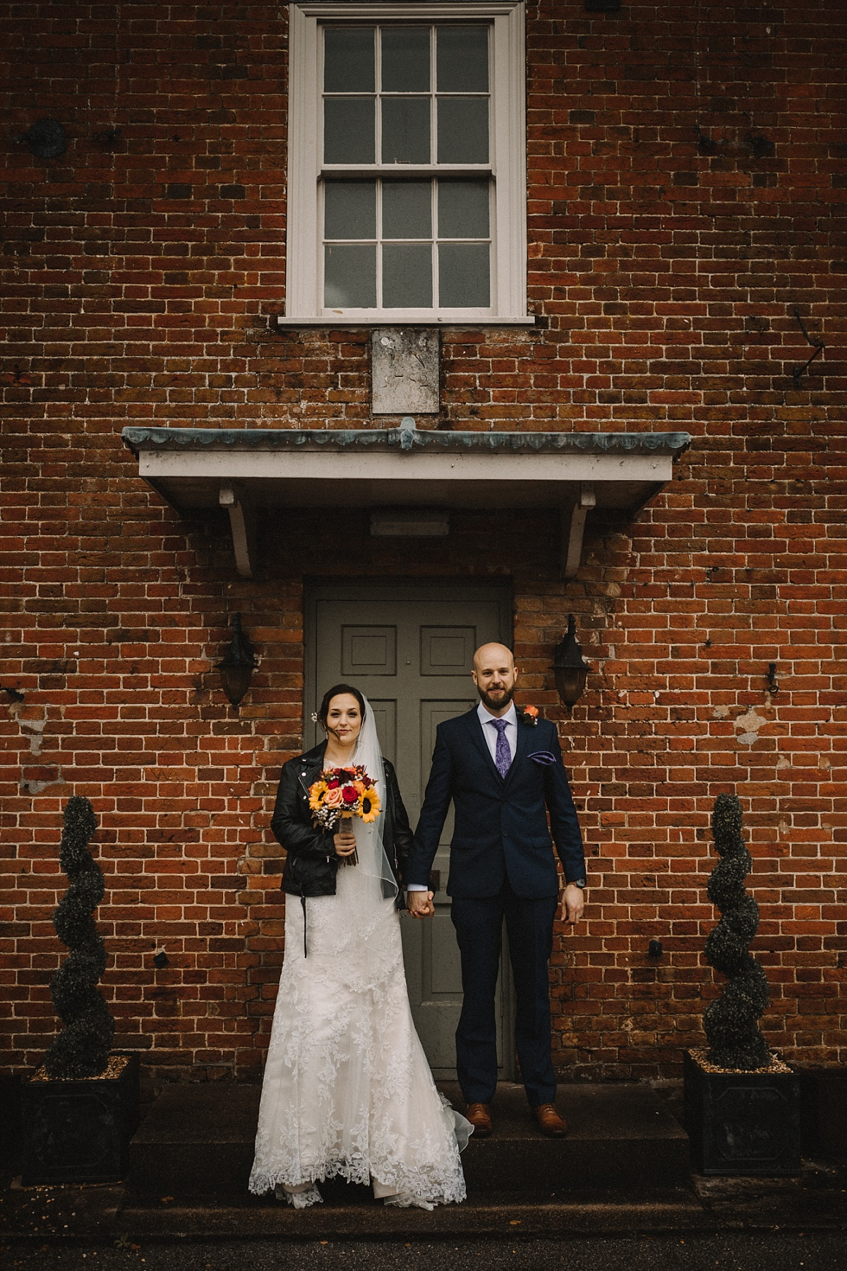 wedding couple outside The Bell Inn New Forest