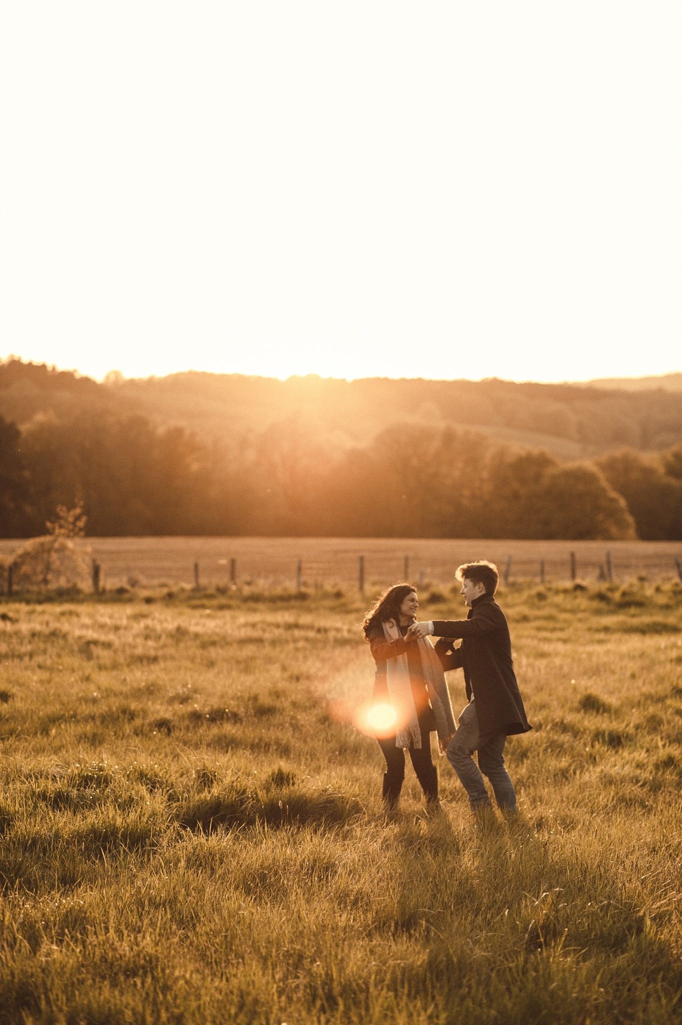 Couple practicing first dance in field in West Sussex