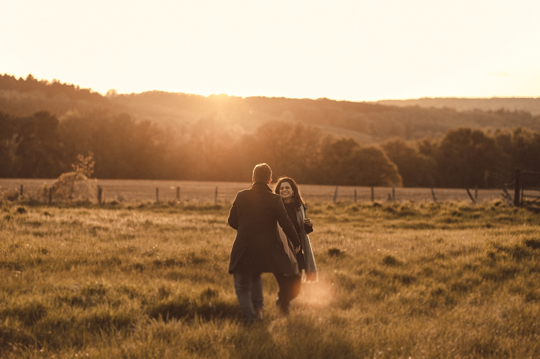 Couple in West Sussex dancing in field