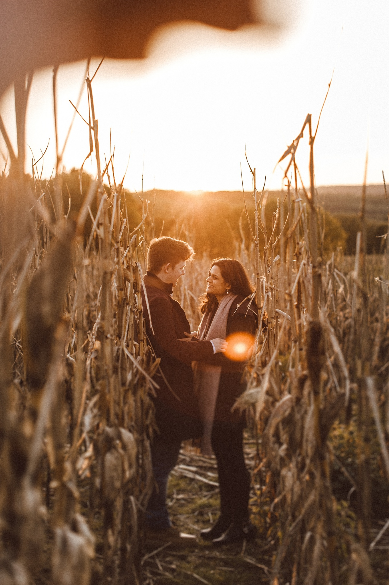 Cool couple standing in corn field in West Sussex